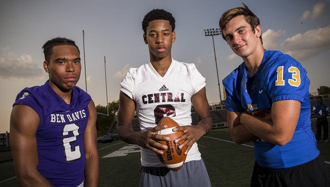 From left, Ben Davis' Reese Taylor, Lawrence Central's Donyell Meredith and Carmel's Jake McDonald are central Indiana choice quarterbacks, photographed Thursday, August 10, 2017 for the 2017 ALL-USA IndyStar preseason football Super Team.