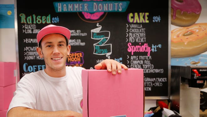 Tate Schienbein of Hammer Donuts Monday, August 21, 2017, inside Discount Den in the Chauncey Hill Mall. Schienbein initially plans to produce about 100 dozen donuts daily.