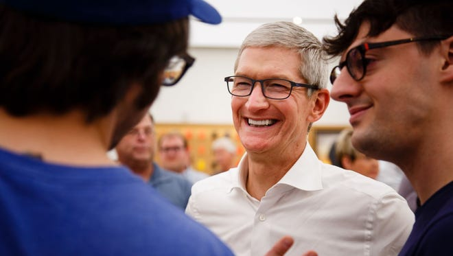 Apple CEO Tim Cook talks with employees on a visit to the West Des Moines Apple Store on Aug. 24, 2017. Cook was in Iowa announcing the company's plans for its $1.375 billion data center in Waukee, Iowa.