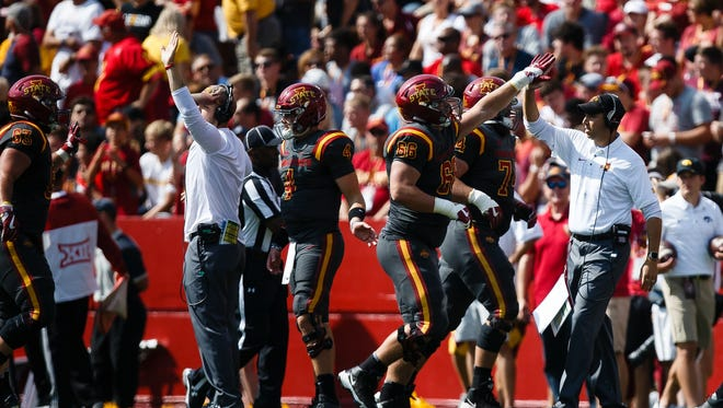 Iowa State head coach Matt Campbell high fives his players after holding Iowa on a fourth down during the first half of their football game at Jack Trice Stadium on Saturday, Sept. 9, 2017, in Ames.