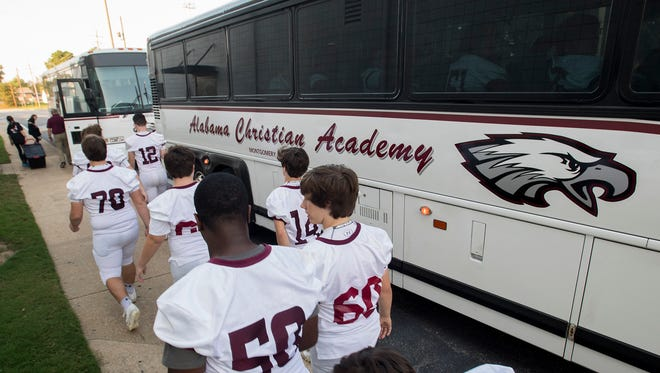 The Alabama Christian Academy football players load onto the bus to the St. James game in Montgomery, Ala. on Friday October 13, 2017.