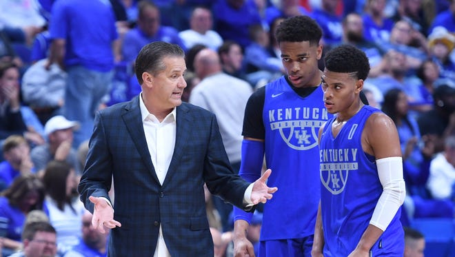 UK head coach John Calipari talks with guard Quade Green during the University of Kentucky mens basketball Blue-White scrimmage in Lexington, Kentucky, on Friday, Oct. 20, 2017.