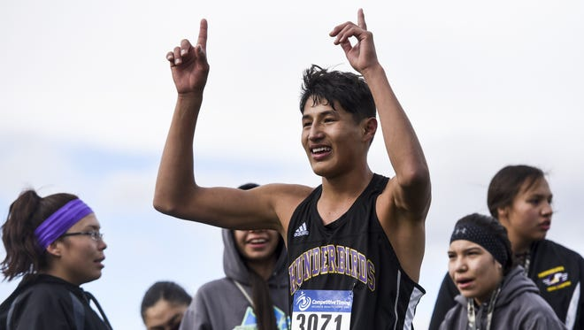 Hays Lodgepole's Isiah Runsabove celebrates after finishing first in the C boys' race with a time of 17:23.6 during the State Cross Country meet in Helena Saturday.