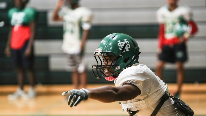 November 08, 2017 - Greg Williams talks to his teammates during football practice at White Station high school.