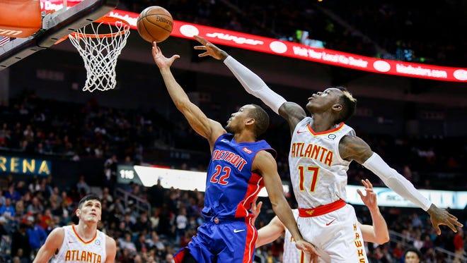 Dec 14, 2017; Atlanta, GA, USA; Detroit Pistons guard Avery Bradley shoots past Atlanta Hawks guard Dennis Schroder in the second quarter at Philips Arena.