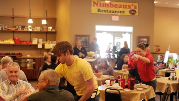 This 2011 Advertiser file photo shows waiter Josh Jagneaux
