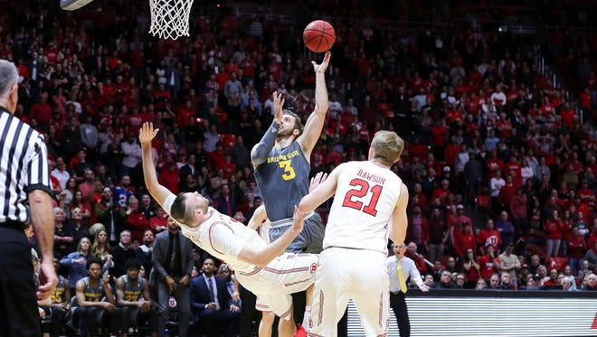 Utah's David Collette fouls ASU's Mickey Mitchell as he shoots the ball during the second half of the Sun Devils' 80-77 win over the Utes.