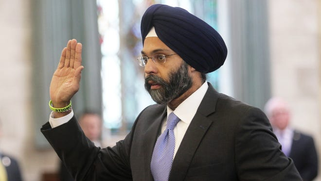 At the State House after the governor's inauguration on Tuesday, attorney general nominee Gurbir Grewal is sworn in before testifying in front of the Senate Judiciary Committee.