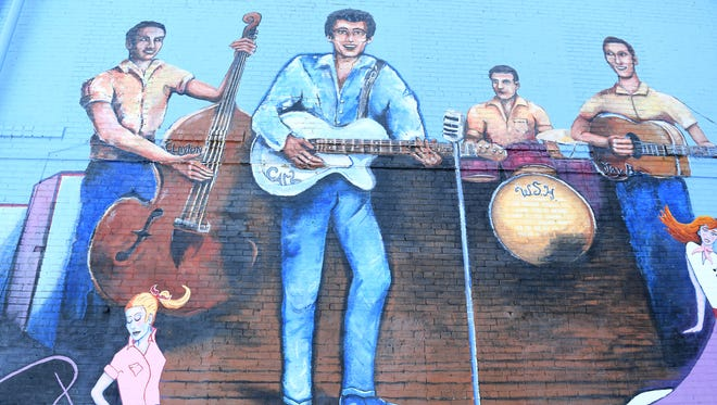 A mural featuring a depiction of Carl Perkins is painted on a wall of the Rockabilly Hall of Fame in downtown Jackson.