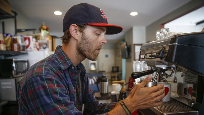 Jon Crawford, coffee shop manager for the Lincoln Lane Coffee Co., which is located inside The Lincoln Center in the Bates-Hendricks neighborhood, prepares a drink on Monday, July 31, 2017.