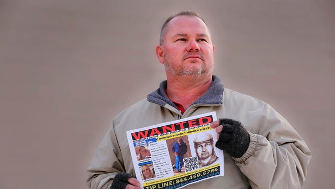 Mike Patty, grandfather of slain Delphi teen Liberty German, with a flier featuring a photograph of the suspected murderer and a tip line, Wednesday, February 7, 2018, in Lafayette. German and Abigail Williams were murdered February 13, 2017, as they hiked the Monon High Bridge Trail just east of Delphi.