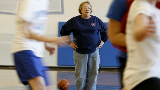 Mary Jo Huismann, basketball head coach of Mother of Mercy High School instructs members of her team during practice. Huismann is one win away from her 600th win. Photo shot Friday November 4, 2010.