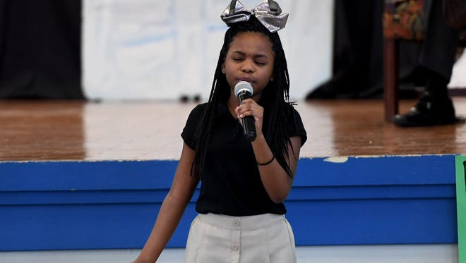 "Alexander Elementary School 5th grader Janiah Sears leads the song ""Rise Up"" during the school's Black History Month program, Thursday, Feb. 22."