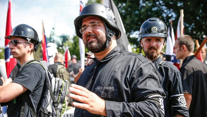 """Matthew Heimbach, an Indiana-based white nationalist, makes his way into Emancipation Park during the """"Unite the Right"""" rally in Charlottesville, Va., on Aug. 12, 2017."""