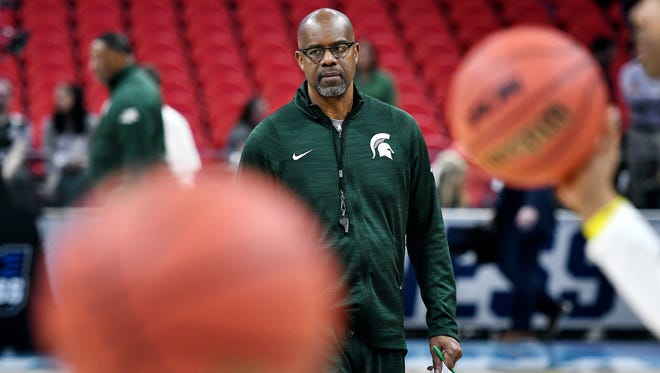 Michigan State's assistant coach Mike Garland looks on during an open practice on Thursday, March 15, 2018, at the Little Caesars Arena in Detroit.