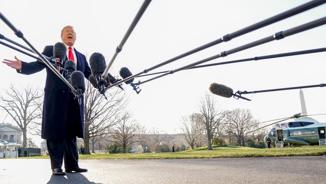 President Donald Trump speaks to reporters before boarding Marine One on the South Lawn of the White House in Washington, Tuesday, March 13, 2018, to travel to Andrews Air Force Base, Md. Trump is beginning a two day trip to California and St. Louis. (AP Photo/Andrew Harnik)