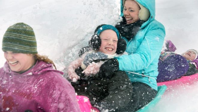 From the left, Shelby Rutherford, Sadie Marshall, Jenna Marshall and Ayah Kline, of Spring Garden Township, slide down Reservoir Hill during a March 21 storm, while schools were closed. There was about 18 inches of wet snow in some spots. The number of snow days this winter season has forced many school districts to change their closing dates.