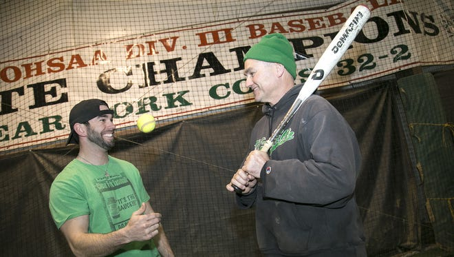 Joe Staab (left) and Rusty Staab (right) share a smile as Joe takes over a Clear Fork baseball program built by his father.