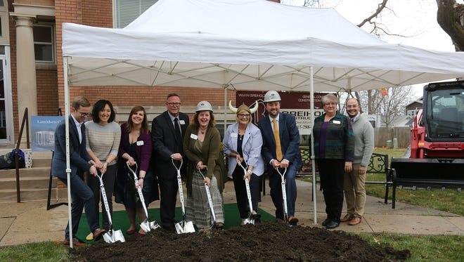 Opera staff pose for a photo during the Des Moines Metro Opera's ceremonial groundbreaking for the Lauridsen Opera Center on April 18.