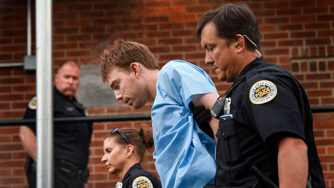 Travis Reinking, the suspect in a deadly shooting at a Waffle House in Antioch, Tenn., is escorted into Hill Detention Center for booking in Nashville on Monday, April 23, 2018.