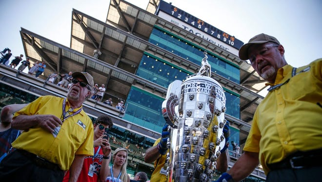 The Borg-Warner Trophy is moved near the racetrack at the Indianapolis Motor Speedway, before the start of the 102nd running of the Indianapolis 500 on Sunday, May 27, 2018.