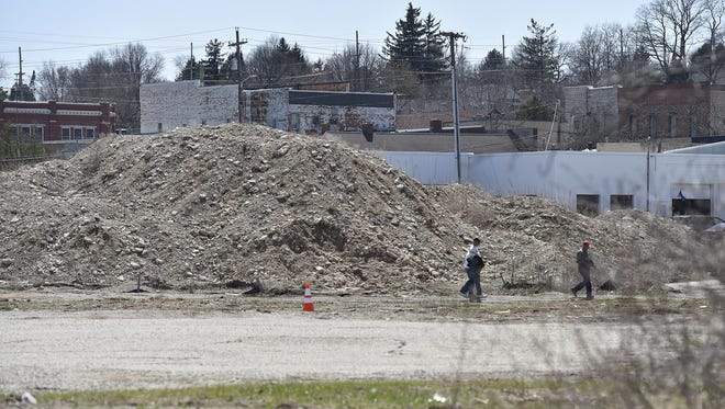 Dirt piles remain along  Sturgeon Bay's west side waterfront, which are remnants of a failed hotel development project.