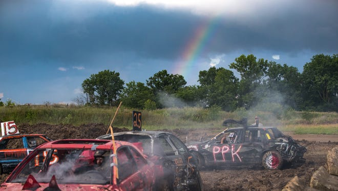 A rainbow shines down as drivers compete in the demolition derby at the Marion County Fair on Friday, June 22, 2018.