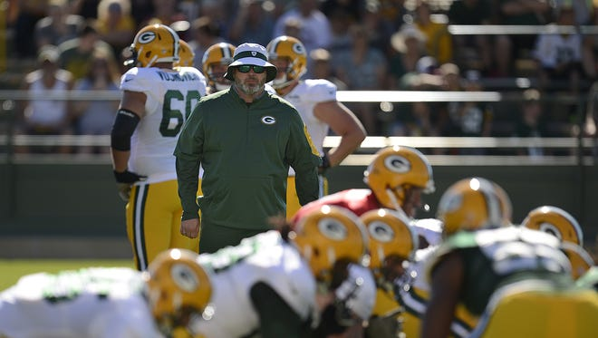 Green Bay Packers coach Mike McCarthy looks on during training camp practice on Aug. 1, 2015, at Ray Nitschke Field.