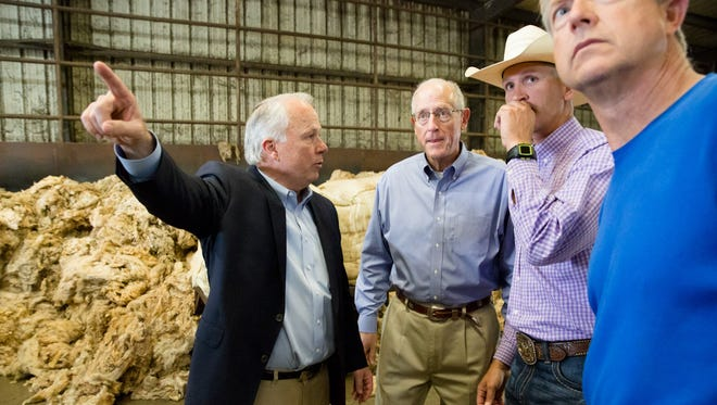 U.S. Rep. Mike Conaway, R-Midland, and other members of the House Committee on Agriculture visit a wool processing fiber mill in San Angelo on July 31, 2017.