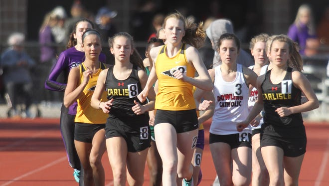 Carlisle's Ella Anderson, Southeast Polk's Mattison Plummer and Carlisle's Megan Sievers run at the front of the pack in the 3,000-meter run. The Simpson College High School Classic was held March 26 in Indianola.