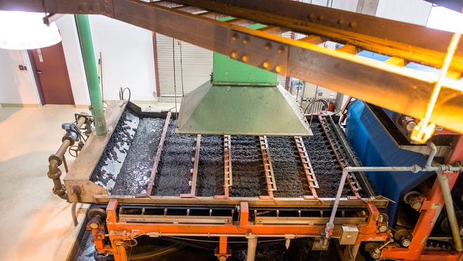 Wet sludge travels through a gravity separator, headed to a belt press, both of which remove water from the product, which can then be incinerated.