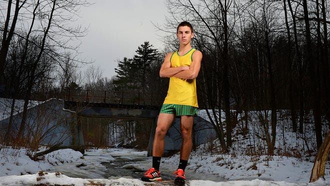 Green Bay Preble's Daniel LaLuzerne, Press-Gazette Media's boys cross-country runner of the year, poses along Baird Creek in Green Bay.