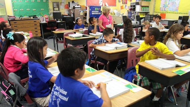 Sherrie Duncan, who regularly works with students needing academic intervention, fills in as a substitute teacher for a fourth grade class at Vista Del Monte Elementary in Palm Springs in 2014.