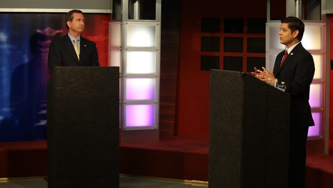 Congressman Raul Ruiz (right) debates 36th Congressional District challenger Assemblyman Brian Nestande (left) debate on Sunday, October 5, 2014 during a live television broadcast at the Gulf California Broadcast Center in Thousand Palms, Calif.