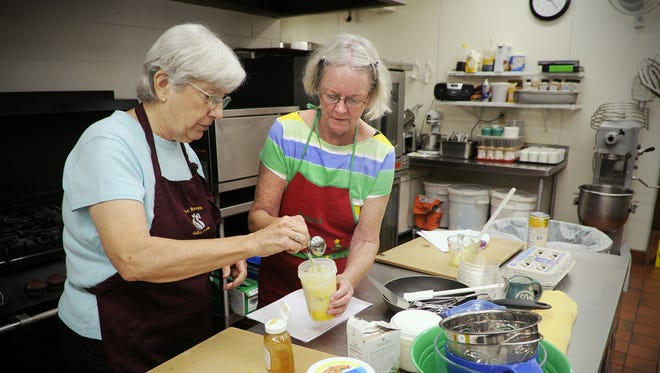 Jan Stavros, left, and Renee Ehlenz, Sauk Rapids, create a dressing for a fruit salad during a cooking class at Whitney Senior Center.
