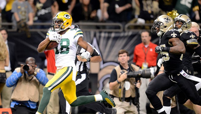 Packers receiver Randall Cobb breaks away for a touchdown reception in the first quarter against the New Orleans Saints.