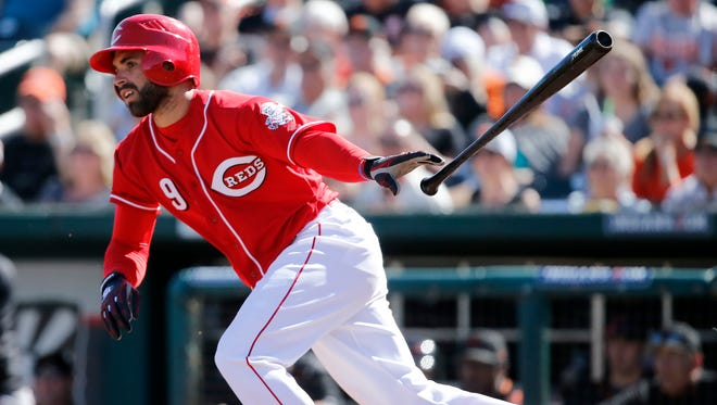 Cincinnati Reds shortstop Jose Peraza (9) takes off for first on a RBI single to the shortstop in the bottom of the second inning of the MLB Spring Training game between the San Francisco Giants and the Cincinnati Reds at Goodyear Ballpark in Goodyear, Ariz., on Sunday, Feb. 26, 2017.