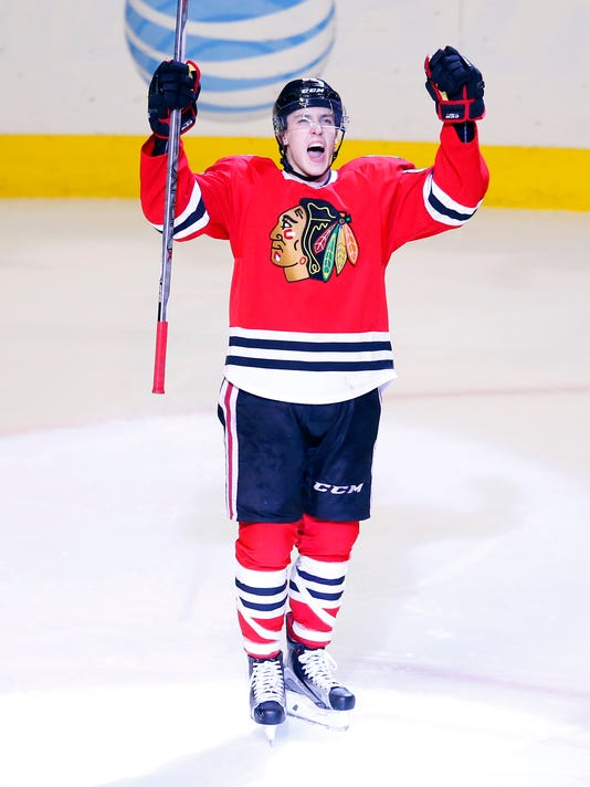Chicago Blackhawks left wing Teuvo Teravainen (86) celebrates his goal against the Toronto Maple Leafs during the third period of an NHL hockey game Monday, Feb. 15, 2016, in Chicago. The Blackhawks won the game 7-2. (AP Photo/Jeff Haynes)