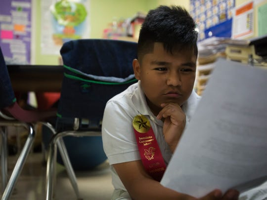 Alejandro Rodriguez, 10, studies his pen pal letter intently at Immokalee Community School January 23rd, 2017.