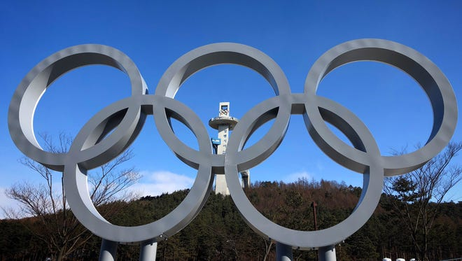 The Olympic rings and the Alpensia Ski Jumping Center are seen in the distance near the Main Press Center in advance of the PyeongChang 2018 Olympic Winter Games.