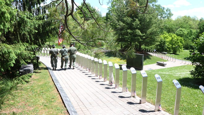 Veterans march as they read the names of the dead at the Vietnam Veterans Memorial on Memorial Day in Rochester.