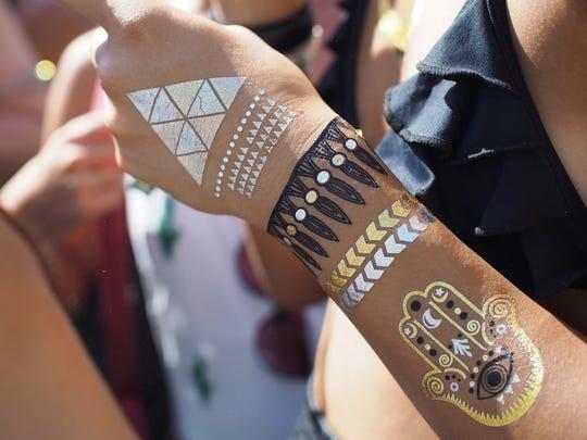 A festival attendee wears body art at the Coachella Music Festival in Indio, California April 11, 2015.