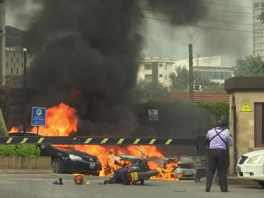 This frame taken from video shows a scene of an explosion in Kenya's capital, Nairobi, Jan. 15, 2019. Gunfire and explosions were reported near an upscale hotel complex.