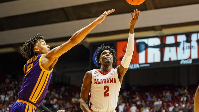 Feb 15, 2020; Tuscaloosa, Alabama, USA; Alabama Crimson Tide guard Kira Lewis Jr. (2) goes to the basket against LSU Tigers forward Trendon Watford (2) during the second half at Coleman Coliseum. Mandatory Credit: Marvin Gentry-USA TODAY Sports