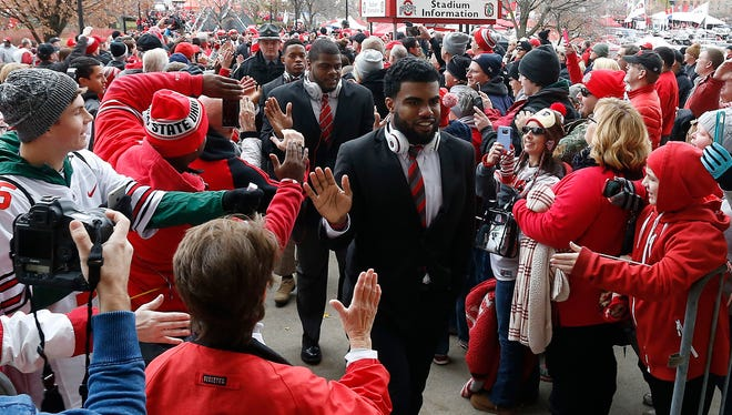 Nov 21, 2015; Ohio State Buckeyes running back Ezekiel Elliott shakes hands with fans while walking into Ohio Stadium prior to the Buckeyes' game against the Michigan State Spartans.