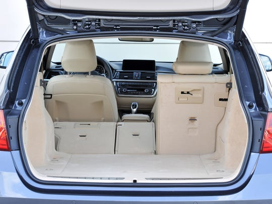 The 2014 BMW 328d xDrive Sports Wagon shows practical can be sexy. The rear hatch opens with the press of a button, opening access to stow plenty of goodies and gear.