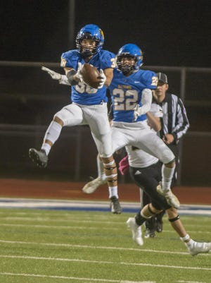 Hutchinson's Devon Hackney leaps for an interception during Friday's 46-41 win over Newton in the first round of the Class 5A playoffs.