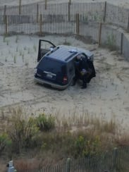 A SUV on the 99th Street dune after the vehicle crashed