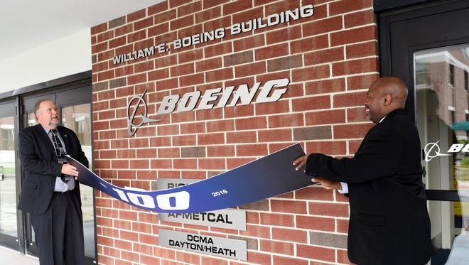 Hank Fitzgerald and Ron Yates of Boeing unveiled the newly renamed William E. Boeing Building in 2016 after a celebration of the aerospace company's 100th anniversary.