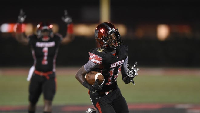 Petal wide receiver Nataurean Watts runs in for a touchdown in a home game against George County High School.